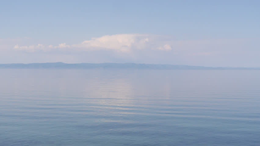 Beautiful panorama of the calm blue surface of the waves and the quiet of the huge lake Baikal
