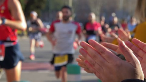 Diverse and Colorful Marathon in Barcelona. People Applauding the Runners. Slow Motion.
