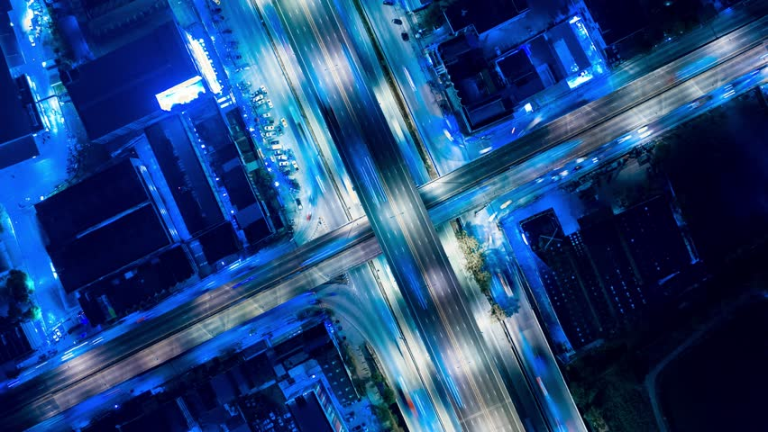 Hyper Time Lapse of Aerial View of Busy Highway Road Junctions at Night from a drone. The Intersecting Freeway Road Overpass The Eastern Outer Ring Road. | Shutterstock HD Video #1025109044