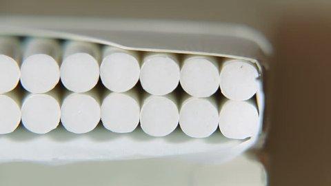 Cigarettes in the cigarette box slider shoot. Pack of light slim filtered cigarettes. Cigarette pack. Box full of cigarettes