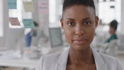 portrait african american business woman entrepreneur smiling enjoying successful startup company proud manager in office workspace