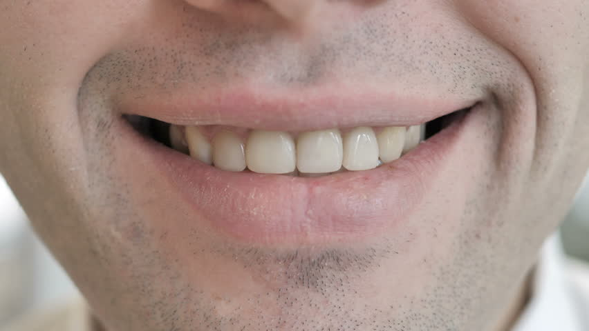 Close Up of Smiling Lips of Young Man   Shutterstock HD Video #1025237024