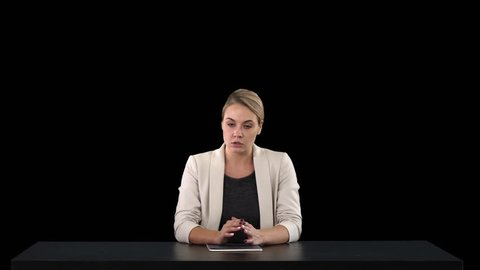 A female newsreader presenting the news, add your own text or image screen behind her, Alpha Channel