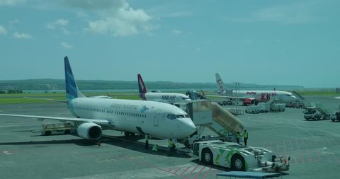 Bali, IDN, 12.17.18, Outdoor airfield scenery Garuda Indonesia, NAM Air and Lion Air at domestic airport / Outdoor airfield scenery Garuda Indonesia, NAM Air and Lion Air at domestic Airport Bali