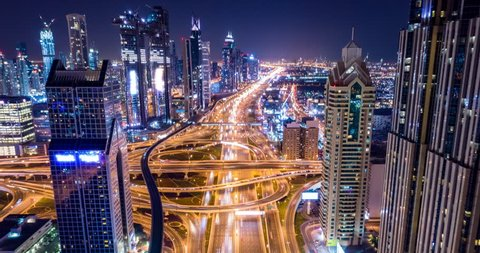 Drone Flight Over Urban Junction Overpass At Night Rush Hour Traffic City Panorama Dubai Business District Low Light Uhd Hdr 4k