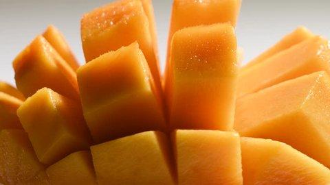 Closeup macro mango pieces rotating around