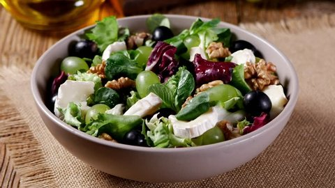 Italian spring salad with goat cheese, grapes and walnuts. Served with croutons. Adding cheese and walnuts.