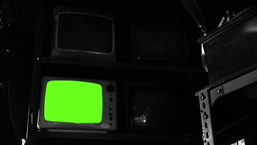 Vintage TV with Green Screen in An Antique Shop. Black and White Tone. Zoom In.    | Shutterstock HD Video #1025371964