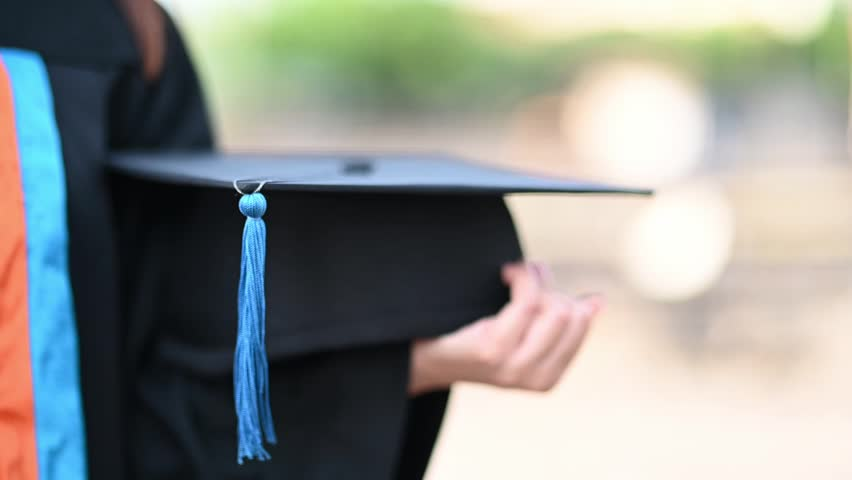 Graduation; cap; hat; graduate; university; background; school; college; ceremony; student; education; high; white; celebration; academic; success; people; degree; black; board; knowledge; air; tassel | Shutterstock HD Video #1025474114