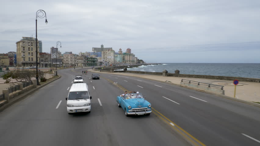 Havana along malecon with vintage cars