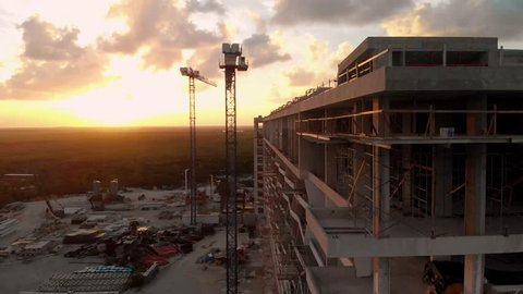A high end hotel construction site next to the beach in Cancun, Mexico at sunset.