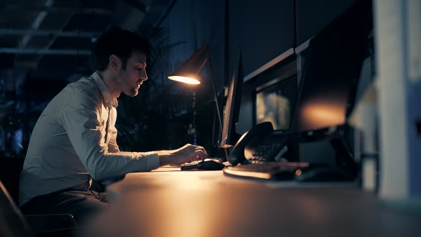 Man Working On Modern Office At Night.Overtime Work In Office.Overworked Businessman Working Late At Night, Alone In The Office.Exhausted Businessman Working Late At The Office.Handsome Man On Job. | Shutterstock HD Video #1025528834
