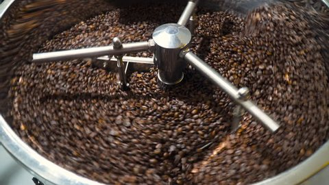 Mixing roasted coffee. Cooling down freshly roasted coffee beans