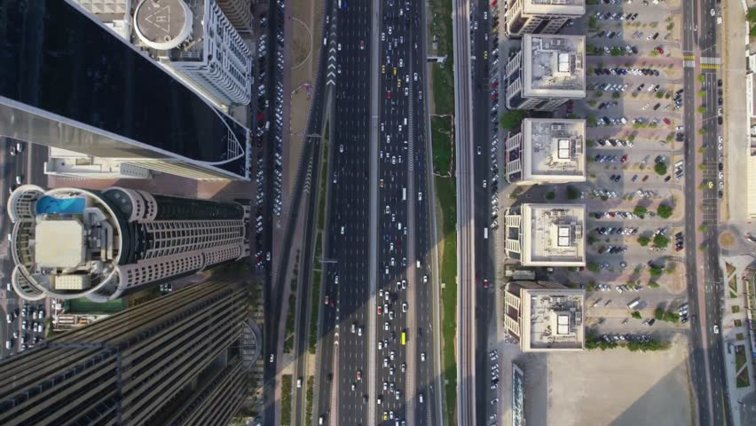 Busy futuristic highway road and modern skyscraper buildings in Dubai city panorama top aerial drone view | Shutterstock HD Video #1025704784