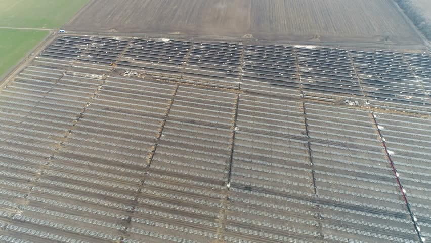 Construction of a solar power station | Shutterstock HD Video #1025718074