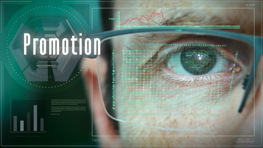 A close up of a businessman eye controlling a futuristic computer system with a Promotion Business concept.