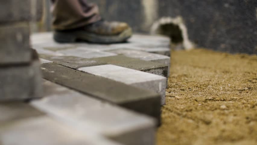 Construction workers laying concrete pavement on the street | Shutterstock HD Video #1025728064