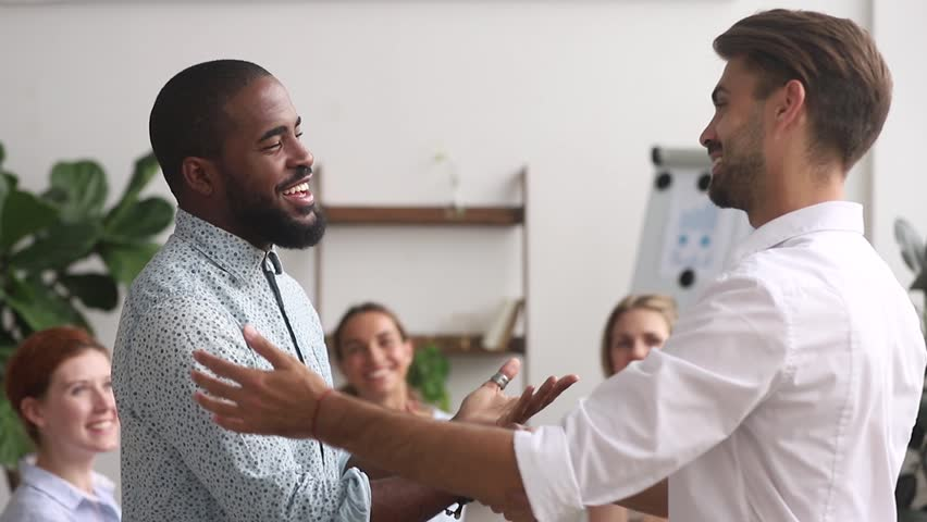 Happy proud excited african american male employee get rewarded appreciated promoted by executive boss manager motivating shaking hand of successful black office worker as gratitude respect concept | Shutterstock HD Video #1025766344