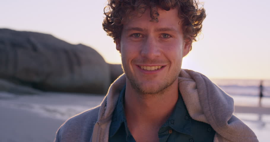 Portrait Of Attractive Man Smiling On Beach At Sunset In Slow Motion Red Dragon 4k