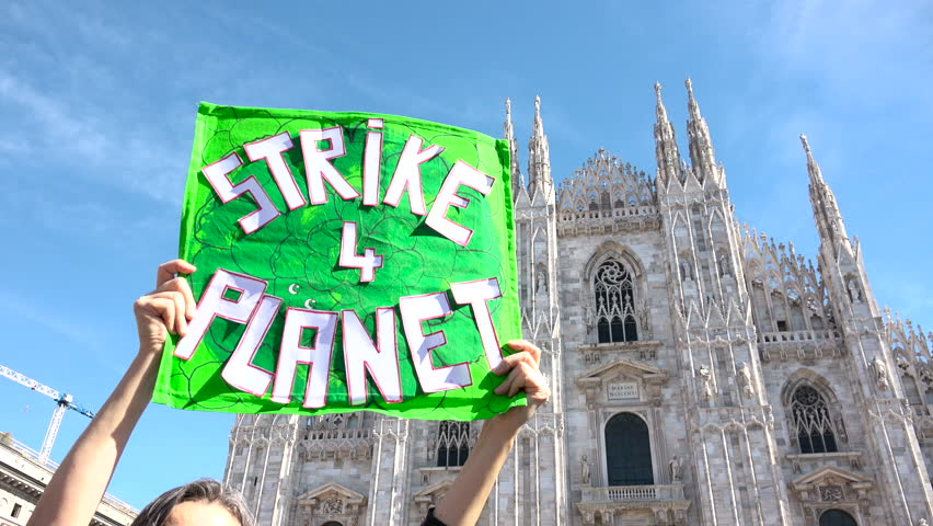 """Picket sign for global strike for climate day, Duomo building, cathedral square, Milan, Italy. Friday for future, Greta Thunberg ecological movement, placard environmental activism """"STRIKE 4 PLANET""""   Shutterstock HD Video #1025791394"""