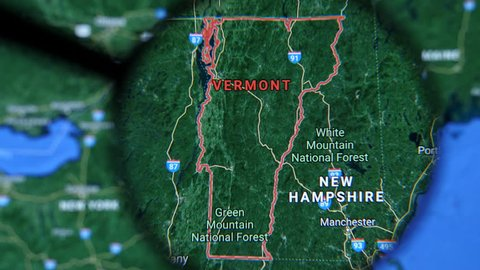 MIAMI BEACH. FLORIDA. USA - MARCH 2019: USA, Vermont on the political map. The borders of Vermont. Vermont State under a magnifying glass. Geography of Vermont in the USA