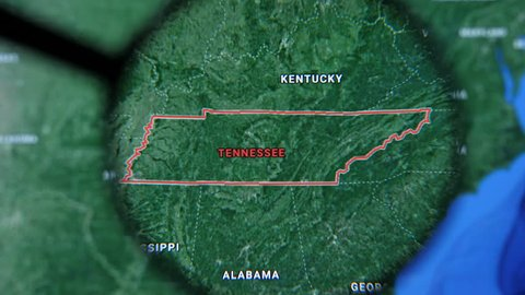 MIAMI BEACH. FLORIDA. USA - MARCH 2019: USA, Tennessee on the political map. The borders of Tennessee. Tennessee State under a magnifying glass. Geography of Tennessee in the USA