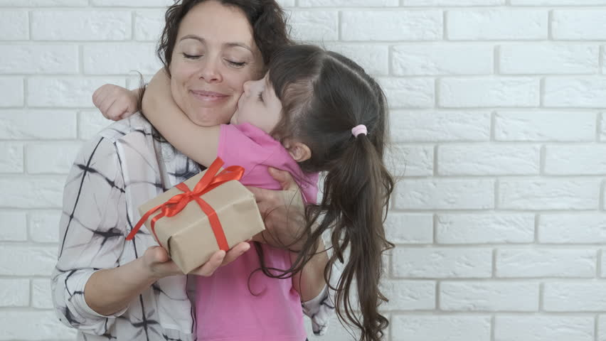 Mothers Day. A little girl gives a gift to the mother. | Shutterstock HD Video #1025828114