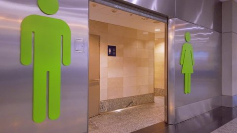 Buenos Aires / Argentina: CIRCA February 2019: Airport Toilets entrance - Gimbal walking shoot - Men and women restrooms doors