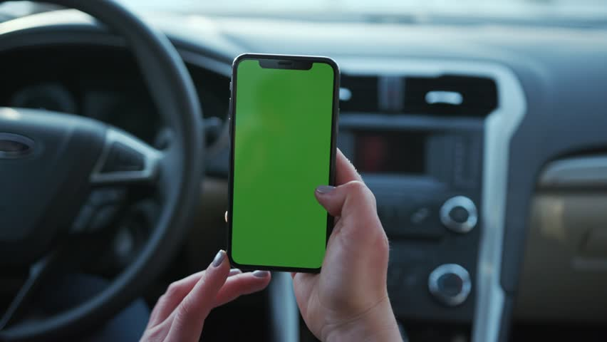 Paris, France - April 5, 2018: In car woman hands holding use phone with vertical green screen transport touchscreen blank connection internet mobile communication smartphone close up slow motion   Shutterstock HD Video #1025899304