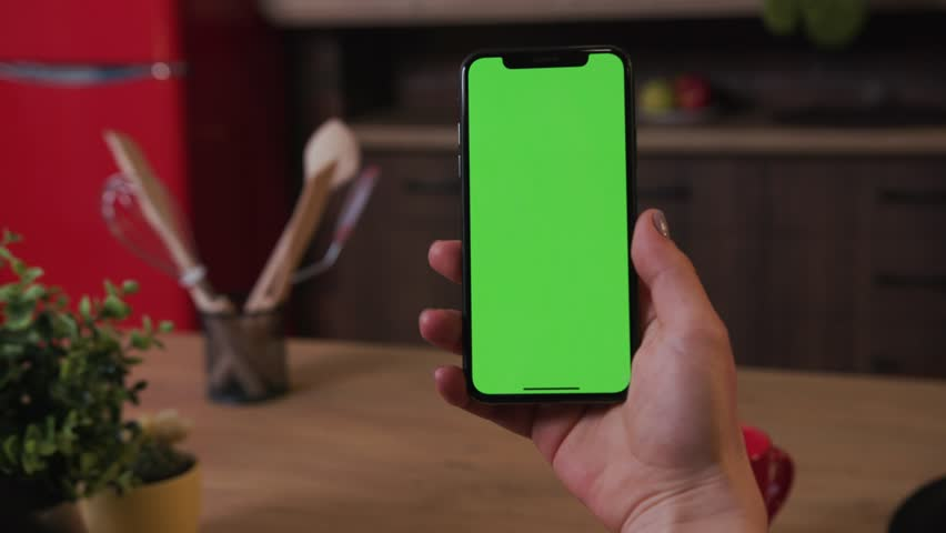 Tokio, Japan - April 7, 2018: Hands woman hold use phone with vertical green screen on kitchen at home breakfast browse business food girl house shopping healthy internet abstract slow motion | Shutterstock HD Video #1025899394