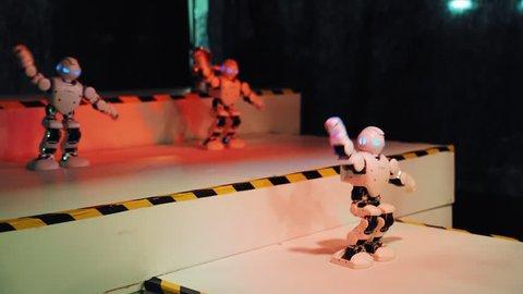 VINNITSA, UKRAINE - MAY 2018: Humanoid robot dance. Group of cute robots dancing. Close up of smart robot dance show. Dancing robot performance. Robotic dance party. Smart robotic technology