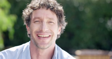 Close up of Attractive Mature man smiling portrait slow motion RED DRAGON
