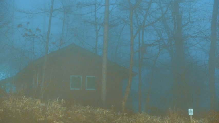 Time lapse of secluded spooky wooden house in a foggy woodland scene. | Shutterstock HD Video #1025919014