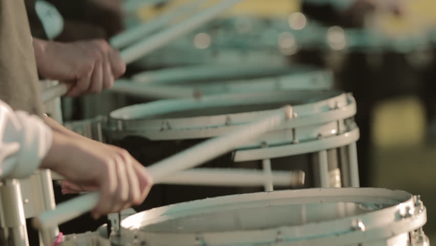 Closeup of hands playing snare drum in drumline in slow motion | Shutterstock HD Video #1025929394
