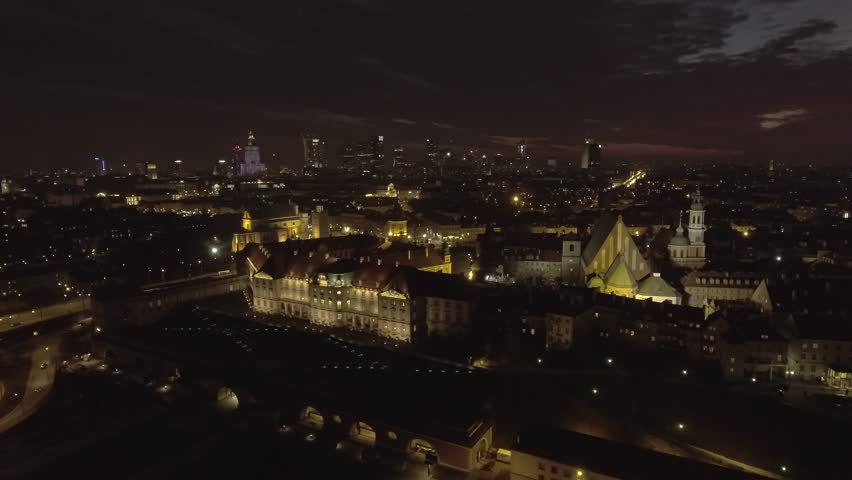 Aerial view of the royal palace in the old town at night Warsaw. Night illumination of the facade is beautifully decorated with ancient buildings. TDrone shot 4k. Video format RAW. | Shutterstock HD Video #1025952944