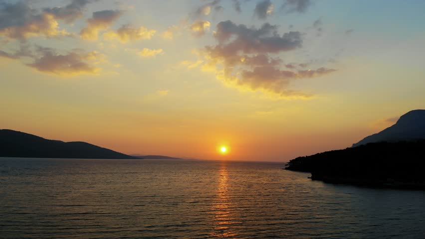 A late autumn sunset video from Akyaka coastline (Gulf of Gokova, the Aegean Sea) shot with a drone flying over the sea.  | Shutterstock HD Video #1025973284