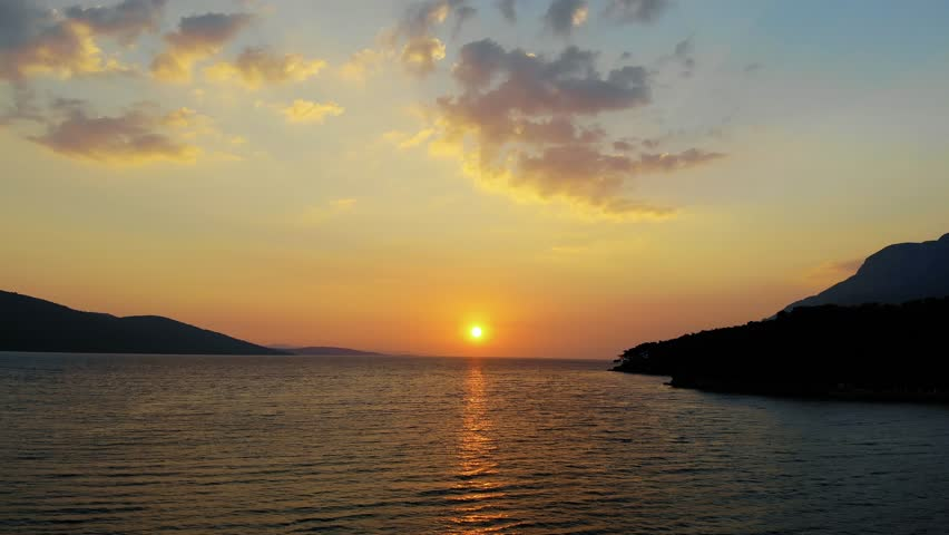 A late autumn sunset video from Akyaka coastline (Gulf of Gokova, the Aegean Sea) shot with a drone flying over the sea.  | Shutterstock HD Video #1025973494