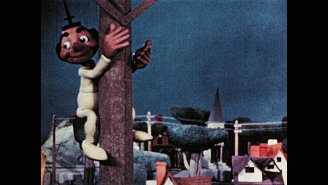 1940s: Marionette climbs telephone pole and sits on top. Marionette speaks and waves.