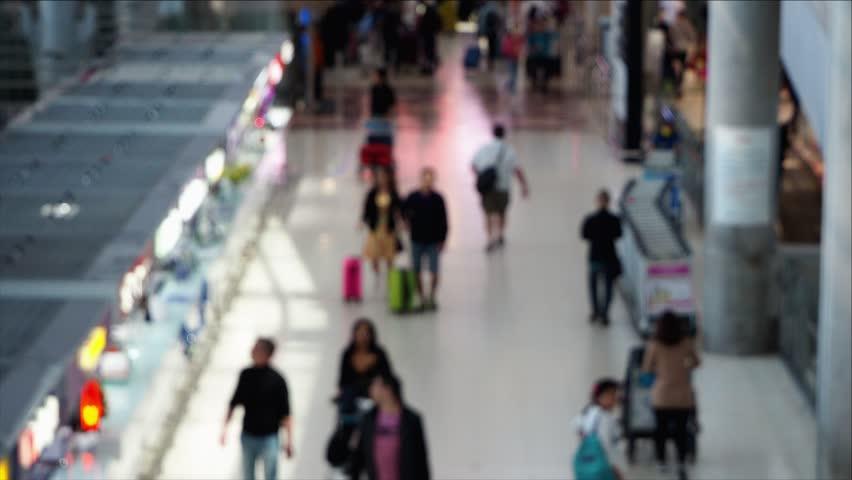 Blurred of tourist passengers walking at international airport. | Shutterstock HD Video #1025991674