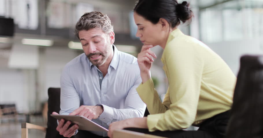 Latin business colleagues in a meeting looking at a digital tablet | Shutterstock HD Video #1025994944