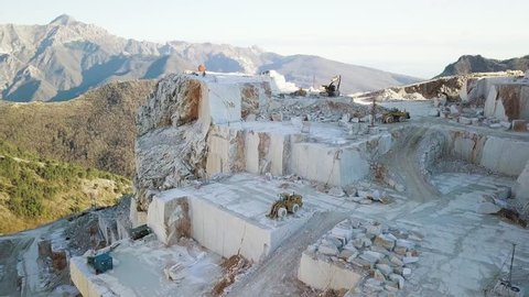 Marble quarry of Carrara. Aerial of the mountain with blocks and excavators.