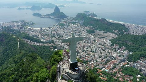 RIO DE JANEIRO, BRAZIL - CIRCA 2016: Aerial view of Christ the Redeemer (monumental statue of Jesus Christ) on top of Corcovado mountain, famous city panorama with Sugarloaf Mountain in background.