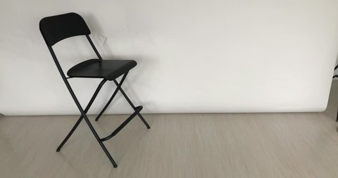 Empty studio chair of the director on a white background with zooming