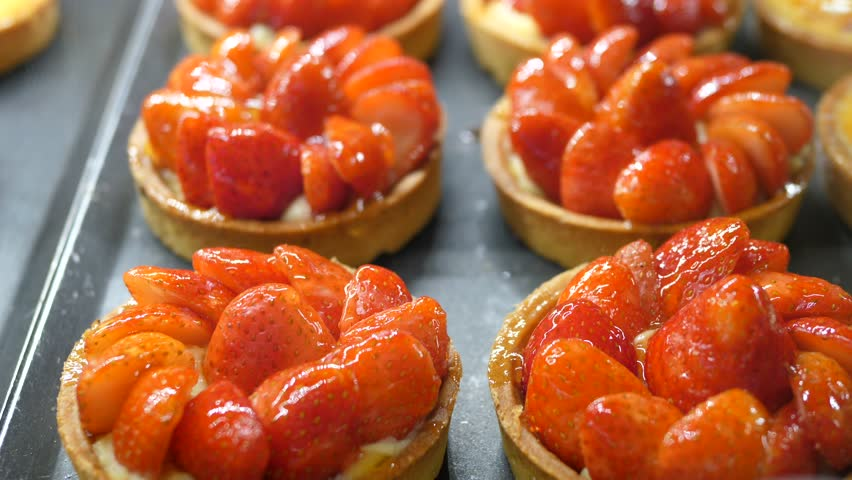 Strawberry Tarts On Display In Bakery.