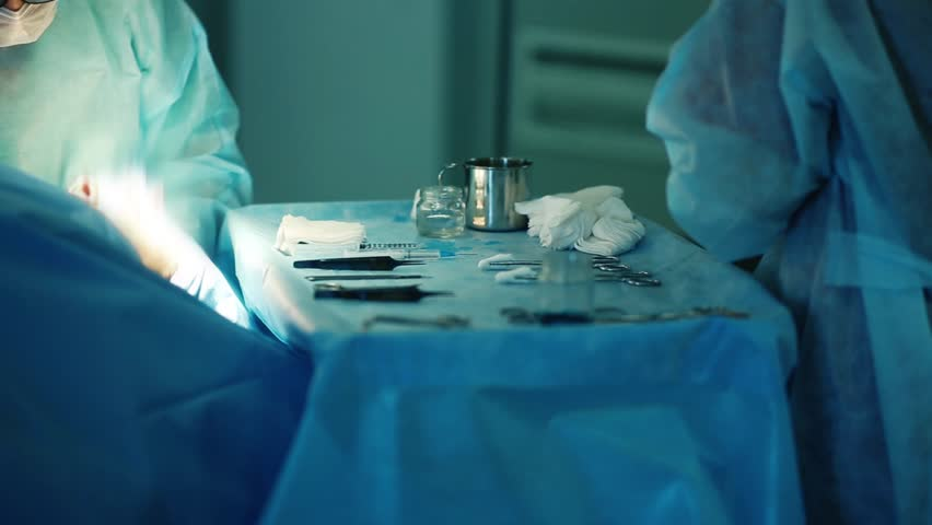 medical instruments surgeon on the background of plastic surgery in the operating room.