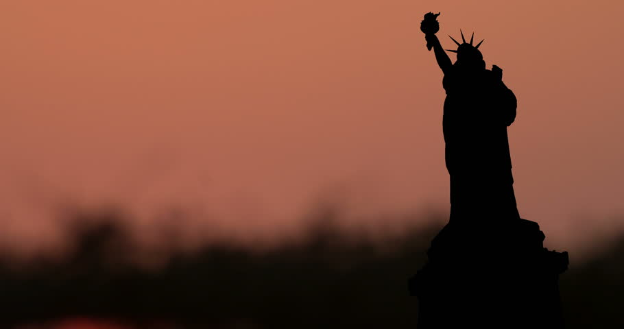 New York The Statue of Liberty.USA Patriotic symbol timelapse silhouette Sunrise | Shutterstock HD Video #1026316544