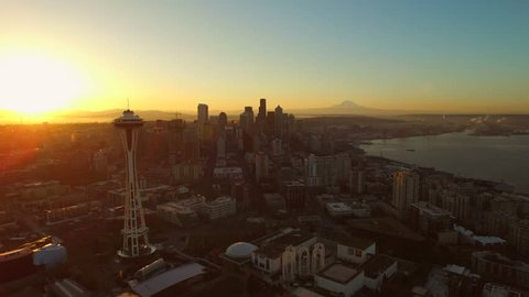 Seattle Aerial v50 Flying low backwards over Lower Queen Anne with cityscape views at sunrise. 3/15