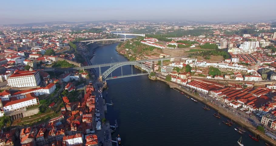 PORTO, PORTUGAL. Breathtaking landscapes over the river. Aerial 4K drone view from above Porto's red-tiled rooftops. | Shutterstock HD Video #1026727994