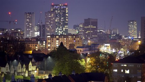 Birmingham city centre at night. Telephoto shot of Birmingham, England, city centre tower blocks at night.