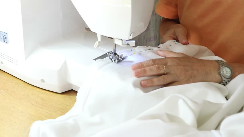 Hoby of homemade sewing making a white sweater using the sewing machine | Shutterstock HD Video #1026807554